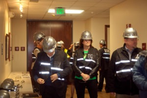 Workshop attendees put on their protective gear prior to the beginning of the tour.