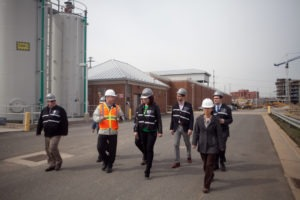 Attendees walk the facilities as part of the tour at Alexandria Renew Enterprises.