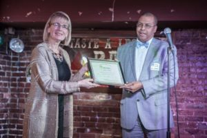 Janine presents Harry Holt with Baby Boomer Award on behalf of Robert L. Wallace