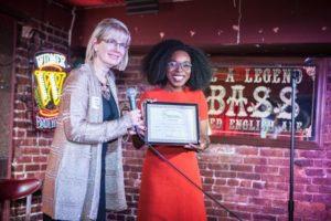 Janine presents Timi Komonibo with the Millennial Award