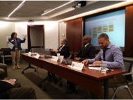 Annette Osso (standing) with panelists Storm Cunninghan, Harrison Newton, and Dwane Jones (l-r)