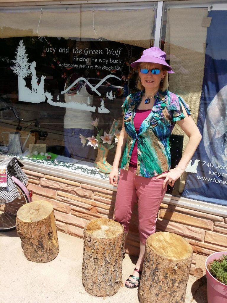 Janine Finnell in front of ″Lucy and the Green Wolf″ store that she came across in Hot Springs, South Dakota which focuses on sustainable living.