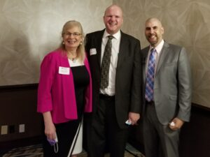 Janine Finnell (left) with Scott Donelson (center), President/Managing Director of Home Energy Medics, and Mike Rosenow (right), Director of Membership at Arlington Chamber of Commerce